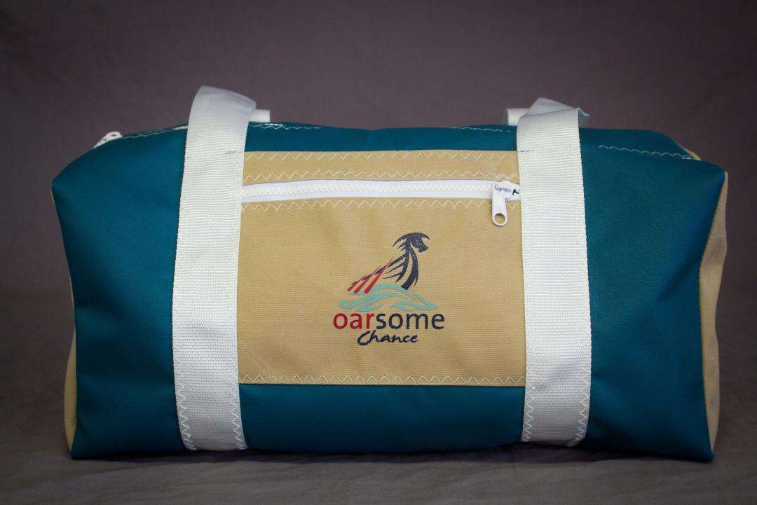 d5a9265dd8 Turquoise and beige canvas holdall with contrast stitching