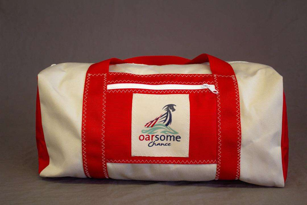 b4e08825ef Red and white canvas holdall with contrast stitching